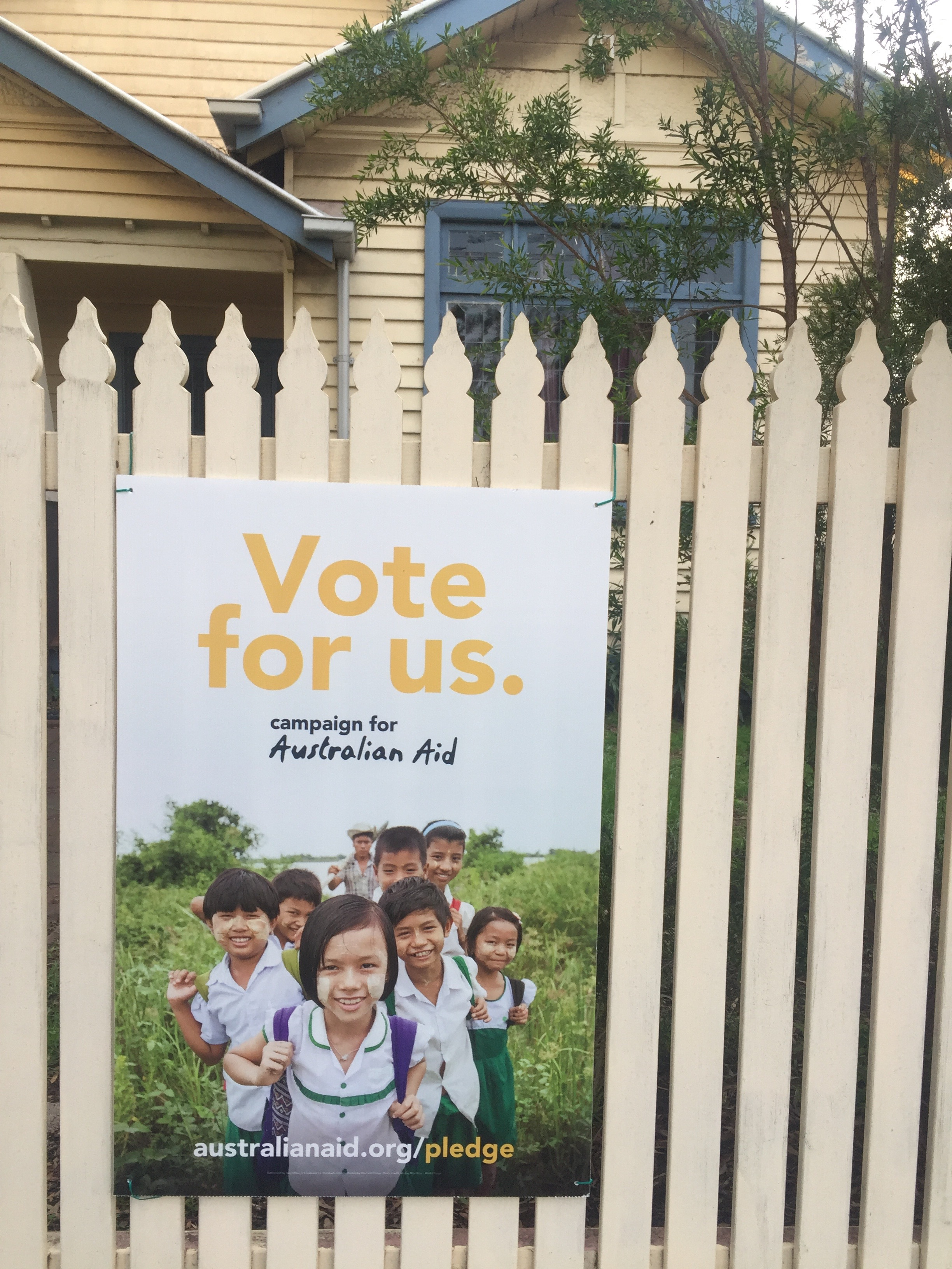 Vote For Us—the poster on my picket fence